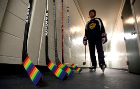 A player walks past Pride taped hockey stick at Claire Drake Arena n Edmonton, Alberta on Dec. 17, 2015. UofA Institute of Sexual Minority Studies and Services announced Pride Tape as a badge of support from the hockey world to the LGBTQ youth. Perry Mah/Edmonton Sun