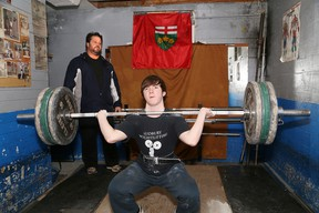 Alex Fera, head coach of the Sudbury Weightlifting Club, works with weightlifter Joel Asselin in Sudbury, Ont. on Wednesday December 16, 2015.