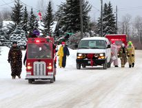 The Whitney Volunteer Fire Department spread some holiday cheer during their annual Santa Claus Candy Run in Porcupine in this file photo from 2014. This Sunday, the Whitney firefighters will once again be delivering candy and collecting donations as part of their East End tradition.