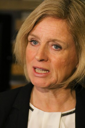Alberta Premier Rachel Notley speaks to reporters after a speech to a crowd of supporters at Stampede Park in Calgary, Ab., on Thursday November 26, 2015. Mike Drew/Calgary Sun/Postmedia Network