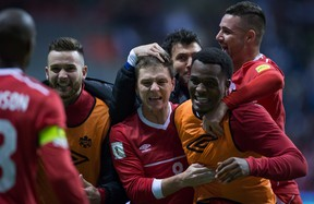 Canada's Will Johnson, centre, Cyle Larin, front right, and Marcus Haber, back right, celebrate after defeating Honduras 1-0 during a CONCACAF 2018 World Cup qualifying soccer match in Vancouver, B.C., on Friday November 13, 2015. THE CANADIAN PRESS/Darryl Dyck