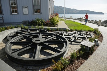 In this photo taken Thursday, Nov. 5, 2015, a man walks along the water outside the Railroad and Ferry Depot Museum in Tiburon, Calif. On the ground floor of the restored building is a detailed operating HO-scale model showing Tiburon as a railroad town from 1900 to 1910.  (AP Photo/Eric Risberg)