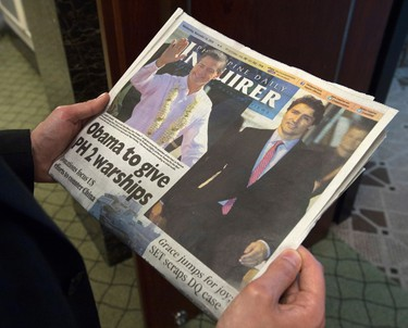 A reader looks at the front page of the Philippine Daily Inquirer in Manila, Philippines on Wednesday, November 18, 2015. Prime Minister Justin Trudeau or Mexican President Enrique Pena Nieto? That was the burning question asked on the front page of a Manila newspaper Wednesday morning as the first day of the Asia Pacific Economic Co-operation leaders' summit opened. THE CANADIAN PRESS/Sean Kilpatrick