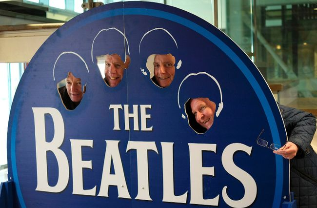 Tourists poses as Beatles in a themed coffee shop in Liverpool northern England, Britain, March 2, 2015. (REUTERS/Phil Noble)