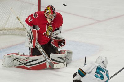 Dec 18, 2015; Ottawa, Ontario, CAN; Ottawa Senators goalie Craig Anderson (41) makes a save against San Jose Sharks center Tommy Wingels (57) in the third period at the Canadian Tire Centre. The Senators won 4-2. Mandatory Credit: Marc DesRosiers-USA TODAY Sports