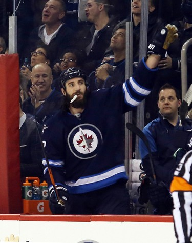 Dec 18, 2015; Winnipeg, Manitoba, CAN; Winnipeg Jets right wing Chris Thorburn (22) celebrates his milestone game passing former Atlanta player Ilya Kovalchuck (not pictured) for most game with the franchise during the game against the New York Rangers at MTS Centre. Mandatory Credit: Bruce Fedyck-USA TODAY Sports