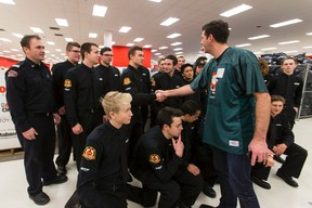 Mayor Don Iveson thanks Edmonton fire cadets for helping out during 630 CHED Santas Anonymous delivery weekend at Bonnie Doon Mall in Edmonton, Alta., on Saturday December 19, 2015. The charity, through the work of volunteers, delivers Christmas gifts to less fortunate families across the city. Ian Kucerak/Edmonton Sun/Postmedia Network
