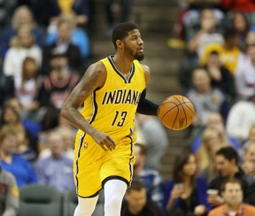 Indiana Pacers forward Paul George brings the ball up court against the Miami Heat at Bankers Life Fieldhouse. (Brian Spurlock/USA TODAY Sports)
