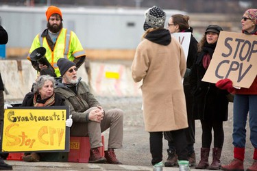 Actor James Cromwell joins protesters at a power plant that is under construction in Wawayanda, N.Y., Friday, Dec. 18, 2015. New York state police say the several protesters who were arrested blocked an entrance to the construction site at the Competitive Power Ventures power plant. (Erik Gliedman/Times Herald-Record via AP)