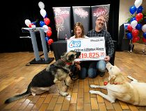 Dogs making a mess leads to winning lotto ticket for Alberta couple