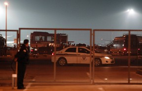 A police car drives on the tarmac of Sabiha Gokcen airport in Istanbul in this February 7, 2014 file photo. (REUTERS/Osman Orsal)