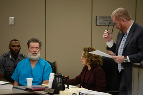 Robert Lewis Dear glares at his attorney Daniel King during an outburst in court appearance on Wednesday, Dec. 9, 2015, in Colorado Springs, Colo. Dear, accused of killing three people and wounding nine others at a Colorado Springs Planned Parenthood clinic on Nov. 27, plans to represent himself. (Andy Cross/The Denver Post via AP, Pool)