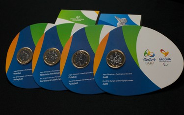 Rio 2016 Olympic Games special edition commemorative coins are displayed during a media presentation at the Maracana stadium in Rio de Janeiro, Brazil on Aug. 6, 2015. Rio will host the Summer Olympics will run from August 5th to the 21st. (Silvia Izquierdo/AP Photo)