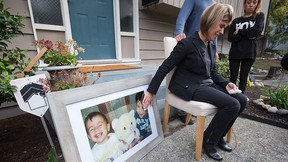 Tima Kurdi, touches a photo of her nephews Alan, left, and Ghalib Kurdi while speaking to the media outside her home in Coquitlam, B.C., in this Sept. 3, 2015 file photo.  THE CANADIAN PRESS/Darryl Dyck