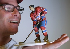 Michael Gossack, president of MY3DAGENCY.COM, holds a sports figure created through 3D printing in Toronto on Friday December 11, 2015. (Veronica Henri/Toronto Sun/Postmedia Network)