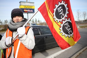 A locked-out worker mans the picket line during the weekend at the OLG Rideau-Carleton Raceway Slots. JULIENNE BAY/Postmedia Network
