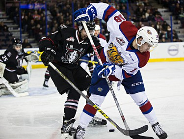 Edmonton's Kobe Mohr battles with Red Deer's Colton Bobyk during the Edmonton Oil Kings' WHL hockey game against the Red Deer Rebels at Rexall Place in Edmonton, Alta., on Monday, Dec. 28, 2015. Codie McLachlan/Edmonton Sun/Postmedia Network