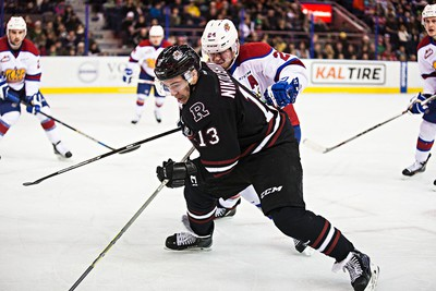 Edmonton's Aaron Irving harasses Red Deer's Ivan Nikolishin during the second period of the Edmonton Oil Kings' WHL hockey game against the Red Deer Rebels at Rexall Place in Edmonton, Alta., on Monday, Dec. 28, 2015. Codie McLachlan/Edmonton Sun/Postmedia Network