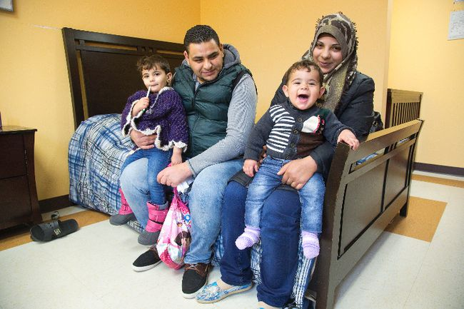 Syrian refugees Mohammad Al Amour and Shoroq Abo Arah with their children Aya and Rasheed at the Cross Cultural Learning Centre where they are beginning a new chapter of their lives in London, Ont. on Tuesday December 29, 2015. The family arrived in Canada on Sunday. (DEREK RUTTAN, The London Free Press)