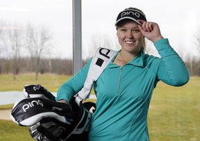 Brooke Henderson poses for a photo at the Smiths Falls Golf Club on Monday, December 21, 2015. THE CANADIAN PRESS/ Patrick Doyle