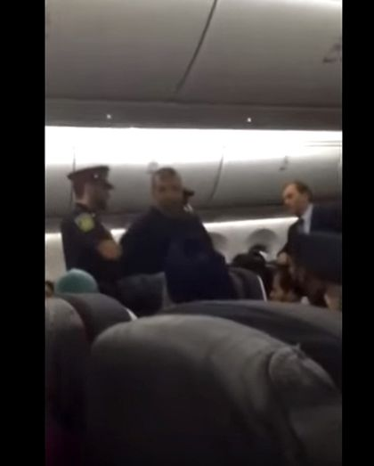Peel Regional Police are seen arresting a man who allegedly assaulted a flight attendant on an Air Canada flight in this still from a video posted to YouTube.