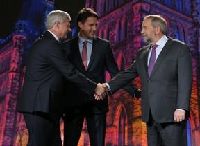 Liberal Party leader Justin Trudeau (middle) joins NDP leader Thomas Mulcair (right) and Conservative Party leader Stephen Harper (left) at the first leaders' debate on Thursday September 17, 2015. Stuart Dryden/Calgary Sun/Postmedia Network