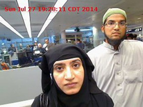 This July 27, 2014 file photo provided by U.S. Customs and Border Protection shows Tashfeen Malik, left, and her husband, Syed Farook, as they passed through O'Hare International Airport in Chicago. (U.S. Customs and Border Protection via AP, File)