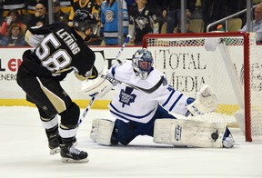 Maple Leafs goalie Jonathan Bernier makes the game-winning save against Penguins defenceman Kris Letang in a shootout during NHL action in Pittsburgh on Wednesday, Dec. 30, 2015. (Don Wright/USA TODAY Sports)