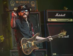 This June 26, 2015 file photo shows Motorhead bassist Lemmy Kilmister performing on the Pyramid stage during Glastonbury Music Festival at Worthy Farm, Glastonbury, England. Joel Ryan/Invision/AP, file