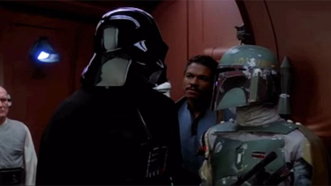 """Darth Vader and Boba Fett are pictured in The Empire Strikes Back. Jason Wingreen, who provided the voice of Star Wars bounty hunter Boba Fett in The Empire Strikes Back, has died at age 95. (<a href=""""https://www.youtube.com/watch?v=bHCKVDcVUwk"""" target=""""blank"""">YouTube screengrab</a>)"""