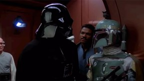Darth Vader and Boba Fett are pictured in The Empire Strikes Back. Jason Wingreen, who provided the voice of Star Wars bounty hunter Boba Fett in The Empire Strikes Back, has died at age 95. (YouTube screengrab)