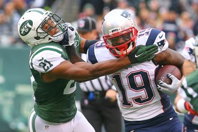 New England Patriots wide receiver Brandon LaFell runs with the ball while New York Jets free safety Marcus Gilchrist attempts to tackle him during the first half at MetLife Stadium in East Rutherford, N.J., on Dec. 27, 2015. (Ed Mulholland/USA TODAY Sports)