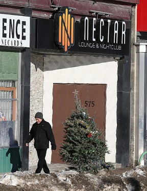A pedestrian walks past Nectar Nightclub at 575 Portage Ave. in Winnipeg on Sun., Jan. 3, 2015. A 31-year-old man faces a number of charges including attempted murder following an alleged domestic altercation that police say began outside the club in the early hours of Jan. 1. (Kevin King/Winnipeg Sun/Postmedia Network)