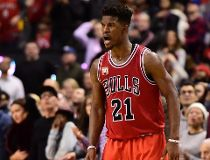 Chicago Bulls' Jimmy Butler celebrates a three-point basket against the Toronto Raptors during second half NBA basketball action in Toronto on Sunday, Jan.3, 2016. THE CANADIAN PRESS/Frank Gunn