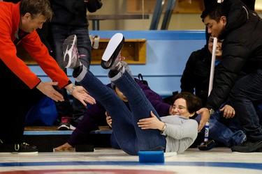 A NAIT international student slips on the ice as students try curling for the first time at the Avonair Curling Club, 10607 Princess Elizabeth Ave. , in Edmonton Alta. on Monday Jan. 4, 2016. David Bloom/Edmonton Sun/Postmedia Network