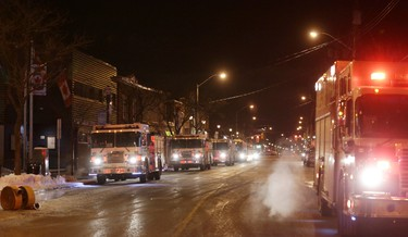 OTTAWA - January 5, 2016 - Fire trucks Richmond Rd. in Westboro (Ottawa), Tuesday, January 5, 2016. Firefighters were called to an early morning two-alarm blaze at an under construction home on nearby Roosevelt Ave. There were no reported injuries. MIKE CARROCCETTO / OTTAWA SUN / POSTMEDIA NETWORK