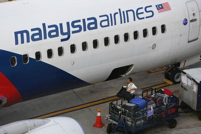 """Malaysia Airlines barred passengers from checking in baggage on flights to Paris and Amsterdam in early January 2016 due to """"unseasonably strong headwinds"""" on a longer flight path it is taking. Malaysia Airlines said the longer flight path consumes more fuel and this, combined with """"temporary unseasonably strong headwinds, is limiting the airlines' ability to carry baggage in cargo."""" The airline later changed the policy after social media backlash. <a href=""""http://www.canoe.com/Travel/News/2016/01/05/22589824.html"""">Read the full story here</a>. (AP Photo)"""