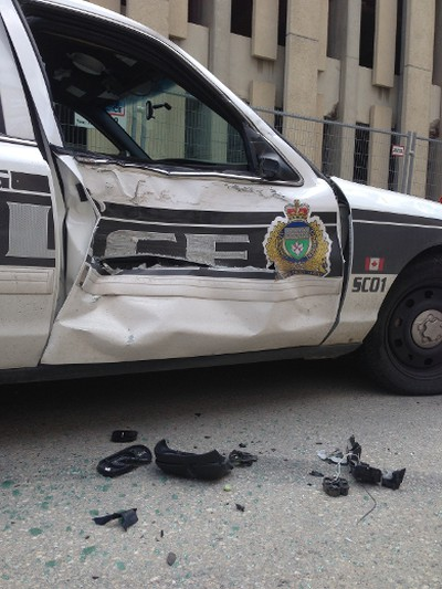 Several Winnipeg police vehicles were rammed in front of the Public Safety Building by a male suspect driving a truck on July 20, 2015. (DAVID LARKINS/WINNIPEG SUN/POSTMEDIA NETWORK)