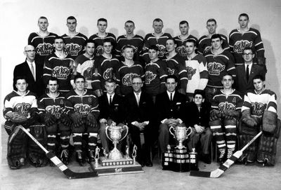 """1963. Members of the Edmonton Oil Kings with the 1963 Memorial Cup, Pat Quinn (2nd from right middle row), Glen Sather (back row 4th from right). Also on that team were; Ron Anderson, Bob """"Butch"""" Barber, Tom Bend, Roger Bourbonnais, Jim Brown, Rich Bulloch, Jim Chase, Vince Downey, Jim Eagle, Ron Falkenberg, Doug Fox, Harold Fleming, Russ Kirk, S. Knox, Bert Marshall, Max Mestinsek, Butch Paul, Greg Pilling, Pat Quinn, Dave Rochefort, Glen Sather, Reg Tashuk. Coach: Buster Brayshaw. Photo Courtesy Edmonton Oil Kings/City of Edmonton Archives"""