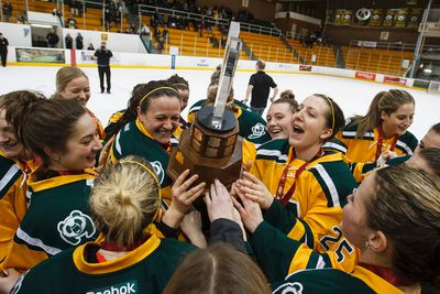 The University of Alberta Pandas celebrate winning the Canada West Championships 3-1 against the University of Manitoba Bisons in Game 2 at Clare Drake Arena at the University of Alberta in Edmonton, Alta., on Saturday, March 7, 2015. Ian Kucerak/Edmonton Sun/ QMI Agency
