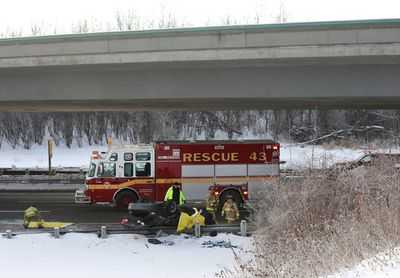 One man is dead after a vehicle went flying off an overpass and fell onto the Hwy. 417 in Ottawa Ontario Wednesday Jan 6, 2016. The single-vehicle crash quickly snarled traffic on the Hwy. 417 eastbound at the 416 interchange, causing major delays for morning commuters.  Tony Caldwell/Ottawa Sun/Postmedia Network