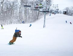 Hundreds of skiers and snowboarders flocked to Boler Mountain as it opened for the first time this season at 4 pm in London. Four runs as well as two beginners hills are operational. (DEREK RUTTAN, The London Free Press)