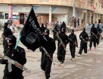 This undated file image posted on a militant website on Jan. 14, 2014, which has been verified and is consistent with other AP reporting, shows fighters from the Islamic State of Iraq and the Levant (ISIL) marching in Raqqa, Syria. (THE CANADIAN PRESS/AP/Militant Website, File)