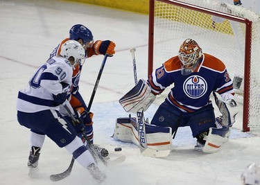 Edmonton Oilers' goalie Cam Talbot (33)   stops  Tampa Bay's Vladislav Namestnikov (90) during second period NHL action at Rexall Place in Edmonton, Alberta on January 8 , 2016. Perry Mah/Edmonton Sun/Postmedia Network