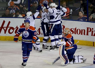 Tampa Bay's players celebrate their 2nd goal during the third period NHL action at Rexall Place in Edmonton, Alberta on January 8 , 2016. Perry Mah/Edmonton Sun/Postmedia Network