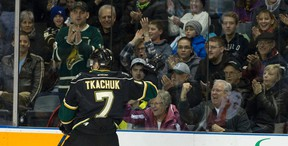 Fans cheer on London Knights forward Matthew Tkachuk as he celebrates his first period goal against the Flint Firebirds during their OHL hockey game at Budweiser Gardens in London, Ont. on Friday January 8, 2016. Craig Glover/The London Free Press/Postmedia Network