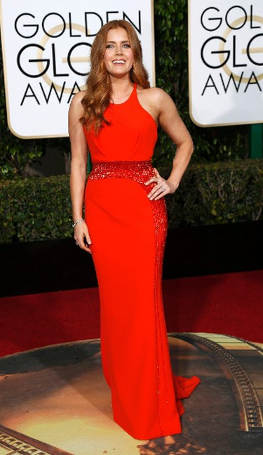BEST in coral. Is it coral? Is it red? Whatever it is, Amy Adams'  Versace dress is simple, yet beautiful. (REUTERS/Mario Anzuoni)