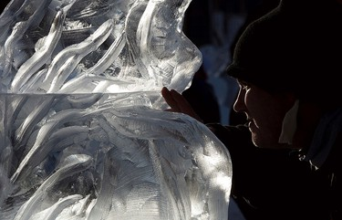 Shane Roever works on an ice sculpture during the ninth annual Deep Freeze Byzantine Winter Festival, in Edmonton Alta. on Sunday Jan. 10, 2016. David Bloom/Edmonton Sun/Postmedia Network