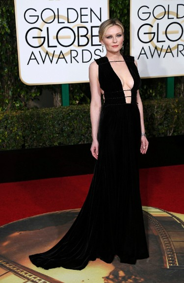 BEST for owning her cleavage goes to Kirsten Dunst in a black floor-length Valentino.  REUTERS/Mario Anzuoni