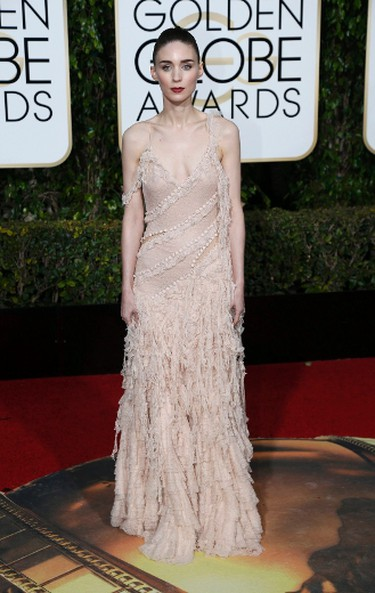 WORST haute couture because there is too much going on. We love Rooney Mara's flawless face and high ponytail but the colour is pale for her skin and the dress is too drapey. (REUTERS/Mario Anzuoni)